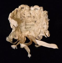Repro - I think this is lace dipped in sizing/papermache and scuplted on a form. Then winding scrolls added to top.