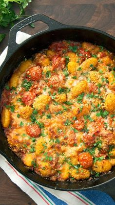 Recipe with video instructions: Switch out spaghetti night with this savory baked dish loaded with gnocchi, tomatoes, capers and cheese. Ingredients: 1 package (about 1 pound) gnocchi, 1 tablespoon butter, Olive oil, 1 small onion, diced, Salt and pepper, 1 cup fresh grape tomatoes, whole, 2 cloves garlic, minced, 1 tablespoon whole capers, drained, 1 teaspoon red pepper flakes, 1/4 cup dry white wine, 1 cup canned crushed tomatoes, 1 tablespoon fresh oregano, chopped, 3/4 cup shred...