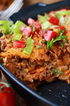 Layered Doritos Casserole is an easy family favorite recipe! Lean ground beef is seasoned with taco seasoning and salsa to create a delicious filling. Layers of Doritos create a delicious casserole which is then topped with our favorite taco inspired toppings!