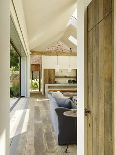 A contemporary poolhouse sitting in the grounds of a Grade 1 listed century Manor House House Styles, House Design, Bungalow Style, Rose Uniacke, Interior Design Styles, Tropical Architecture, Rustic Wood Floors, Pool House, Pool Houses