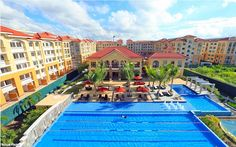 Named after a picturesque Italian resort-town, Sanremo Oasis in Cebu is a mid-rise residential community set amid verdant greens and spacious environs. Oasis Swimming Pool, Visayas, Cebu City, Condominium, Seaside, San, Mansions, House Styles, Hotels