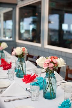 The old fashioned blue mason jars are perfect for a casually elegant beach wedding - they went great with the Sam's Chowder House decor as well.
