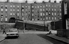 """""""The Turf Depo at the rear of the Gloucester Diamond off Sean MacDermott In those days Government help to the unemployed, was Turf vouchers. Photo Gloucester Diamond tenement houses, with the tenements of Summerhill in the background. Gloucester, Dublin, Old Photos, Multi Story Building, Street View, Twitter, Times, Antique Photos, Old Pictures"""