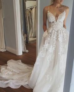 White wedding dress. Brides dream of finding the ideal wedding day, however for this they need the perfect bridal dress, with the bridesmaid's dresses enhancing the brides dress. These are a variety of suggestions on wedding dresses. #weddingdress