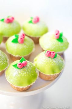 Bright yellow fondant topped cupcakes with pink flowers