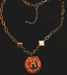 A sweet sculpted and handpainted Chow Chow Necklace by Kathleen Zins, available on ebay til 1-23-2013 !!  under seller artmiz