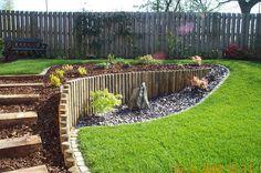 A sloping garden built by Wyld Landscapes by landscaper33, via Flickr