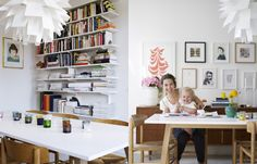 bookshelf on the wall, dining table with white top, art wall   Patric Johansson for Residence