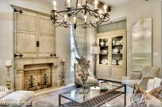 Tv behind custom doors. Designer Julia Blailock