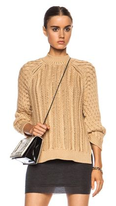 Textured cable stitch viscose-blend sweater by 3.1 Phillip Lim. 65% viscose 35% polyamide.  Made in China.  Knit fabric.  Side slit detail.