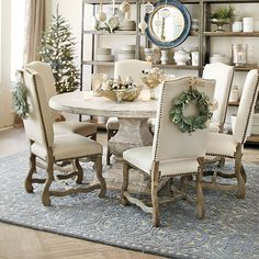 round table and upholstered dining chairs