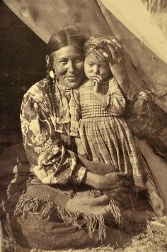First Nations (Sarcee?) mother and child circa late 1800's / early 1900's.   ( Photo of a photo. Taken at the Whyte Museum of the Rockies, in Banff, Alberta.) Source: unknown