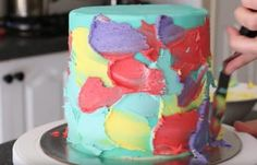 Mom Smears Colorful Frosting Onto Cake, Then Spins The Stand For A Stunning Design