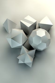 Four platonic solids, a football, and two conjoined tetrahedra