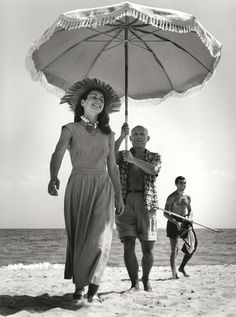 Pablo Picasso with Françoise Gilot and his nephew Javier Vilato on the beach, Golfe-Juan, French Riviera (Robert Capa, August 1948)