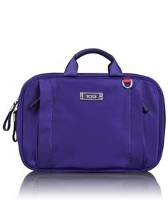 Tumi Luggage Voyaguer Monaco Travel Kit, Pansy, One Size TUMI. $145.00. Zip pockets and metal hanger. Made in China. Side zip pockets. Inside three see-thru compartments, detachable pouch. Top carry handles. 100% Nylon