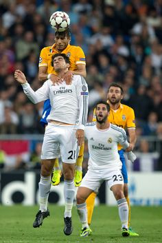 Martín Cáceres wins the header before Álvaro Morata during the UEFA Champions League group B match between Real Madrid CF and Juventus at Estadio Santiago Bernabéu on October 23, 2013 in Madrid, Spain.