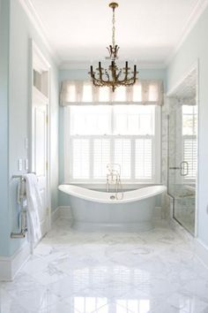 This vintage Parisian-inspired bathroom creates a timeless and peaceful getaway. More dream bathrooms: design design ideas interior design decorating before and after House Of Turquoise, Bathroom Spa, Bathroom Renos, Bathroom Ideas, Bathroom Designs, Bathroom With Window, Royal Bathroom, Window In Shower, Bathtub Ideas