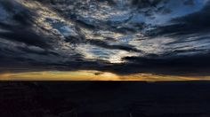 """Nightfall covers the Grand Canyon in darkness even as the sky erupts in a final shower of light. The silver streak near the bottom of the image is the Colorado River. "" #NationalParks #Arizona #sunset #photography   Touching Light Photography - johnbaileyphotoart.com"