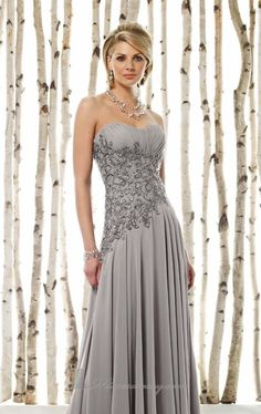 Strapless chiffon evening gown with intricately embellished ruched bodice and flowing fitted skirt by Cameron Blake....
