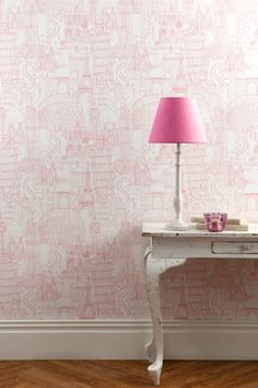 for le petit world traveler: globetrotter wallpaper. Also comes in chocolate, light blue, natural colorways. Clarke & Clarke.