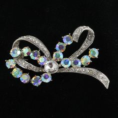 Aurora Borealis Rhinestone Bow Pin Brooch Vintage Jewelry. $17.00, via Etsy.