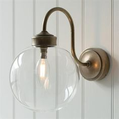 Compton Bathroom/Outdoor Wall Light in Antiqued Brass made by Jim Lawrence