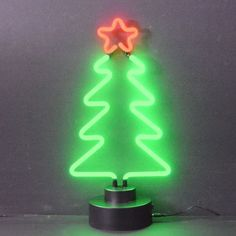 The Christmas Tree Neon Sculpture by Neonetics features multi-colored, hand blown neon tubing. The Christmas Tree Neon Sculpture plugs into a black base, which fully houses all the electronics. The ba
