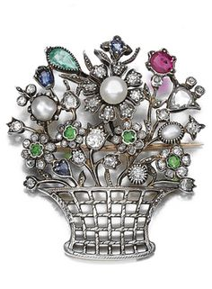 GEM-SET AND DIAMOND BROOCH Set with faceted gemstones including demantoid garnets, sapphires, an emerald, a ruby, cultured pearls and pearls, highlighted with circular- and rose-cut diamonds.