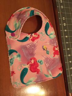 A personal favorite from my Etsy shop https://www.etsy.com/listing/270255012/little-mermaid-baby-bib-newborn