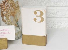 Wood  Table Number - distressed white with metallic burnished gold base and number - Beach wedding - Romantic wedding - Rustic wedding