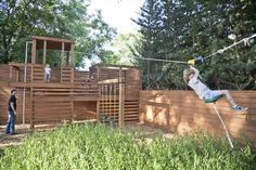 Even backyard play areas can be customized, such as this huge play fort, fence and rope slide (Provided).