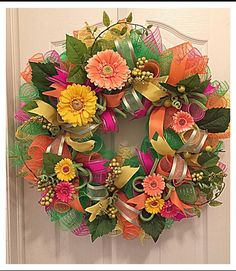 You will love decorating your home or front porch with this beautiful Gerber daisies summer wreath. It is made with high-quality orange, lime, pink and yellow metallic deco mesh. It shows with high-quality Gerber daisies in yellow, pink and orange. There is lime flex tubing, silky