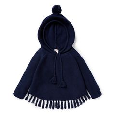 100% Cotton. Knit poncho features tassles and hood with pom pom. Relaxed fitting silhouette. Available in Navy.