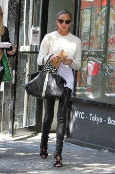 Chrissy Teigen autumn street style with leather skinny pants, crop sweater over a long white shirt and accessorized with Balmain black sandals.  #chrissyteigen