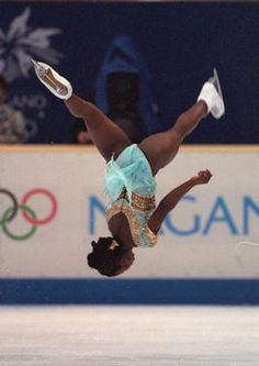 thebeautyisbeast:   Surya Bonaly. French Figure Skater who attempted a quadruple toe loop in the 1991 World Champoinships, and regularly performed backflips landing on only one blade. Overall onebadass figure skating champ!