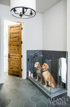 The Sheehans' two golden retrievers, Burton and Roscoe, enjoy the outdoors as much as their children, swimming in the pool on a daily basis. To accommodate the two occasionally soaking-wet dogs, Sheehan incorporated a dog wash in the mudroom right off the entry using custom-cut slate hexagonal tiles that are also easy to clean. #DogBath