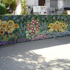 A creative and labor intensive mosaic garden wall. - Yelp