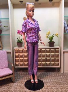 Capri and Campshirt Combo in Liberty of London Saeed. A beautiful print of tiny pansies in shades of purple makes up this summer blouse in the finest cotton lawn.The shirt has a camp collar, short sleeves,side vents and tiny purple buttons.The accompanying capri pants are made from iridescent purple silk.