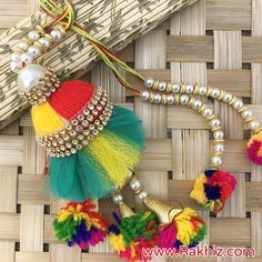 Designer Pom Pom Pearl Lumba Rakhi Embroidery Flowers Pattern, Flower Patterns, Hand Embroidery, Diy Tassel, Tassels, Send Rakhi To India, Buy Rakhi Online, Handmade Rakhi Designs, Thread Jewellery