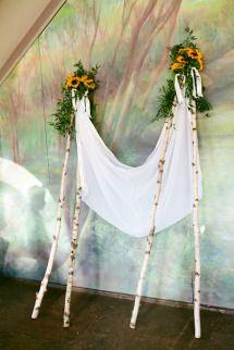 Wedding by Seaport Flowers hand held Chuppah, sunflower