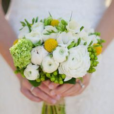 viburnum, white freesia, yellow billy balls, green hypericum berry and white ranunculus