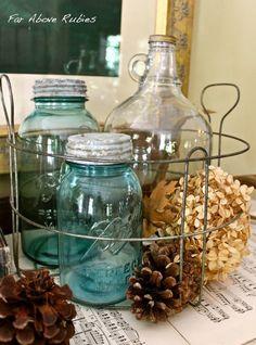 vinegar jugs and blue Mason jars in a vintage canning basket