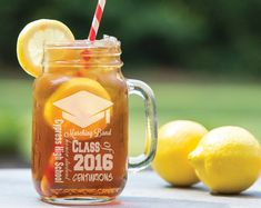 Class of 2017 Graduation Cap Word Art Mason Jar Design Personalized with Name, High School Name, Mascot, Year, and Extracurricular Activity. BASED ON POPULAR DEMAND, NOW AVAILABLE IN TWO SIZES: 16 Oz and 24 Oz Mason Mugs. Please click on the tiny thumbnails under the main image to see a