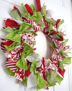 Add a little bit of Holiday cheer to your home with this festive fabric wreath!    This cheerful wreath is filled with a variety of colors and