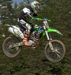 📸 Man in Green White and Black Mtx Suit on Green and White 303 Dirt Motorcycle in the Air - download photo at Avopix.com for free    ☑ https://avopix.com/photo/49234-man-in-green-white-and-black-mtx-suit-on-green-and-white-303-dirt-motorcycle-in-the-air    #motorcycle #bicycle #wheeled vehicle #vehicle #mountain bike #avopix #free #photos #public #domain