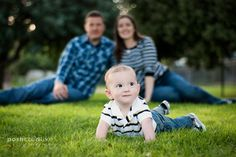 Family Photo Ideas -- Position infant in front with parents blurred, looking on in back.