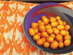 a mix of oranges to brighten any room!  our wire woven african bowl atop a fun, bright textile