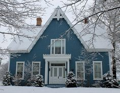 II love this blue house with the white trim. It's very inviting and just makes you want to see what's inside.