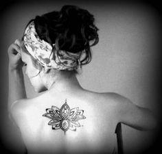 lotus flower tattoo lower back...my tatto <3